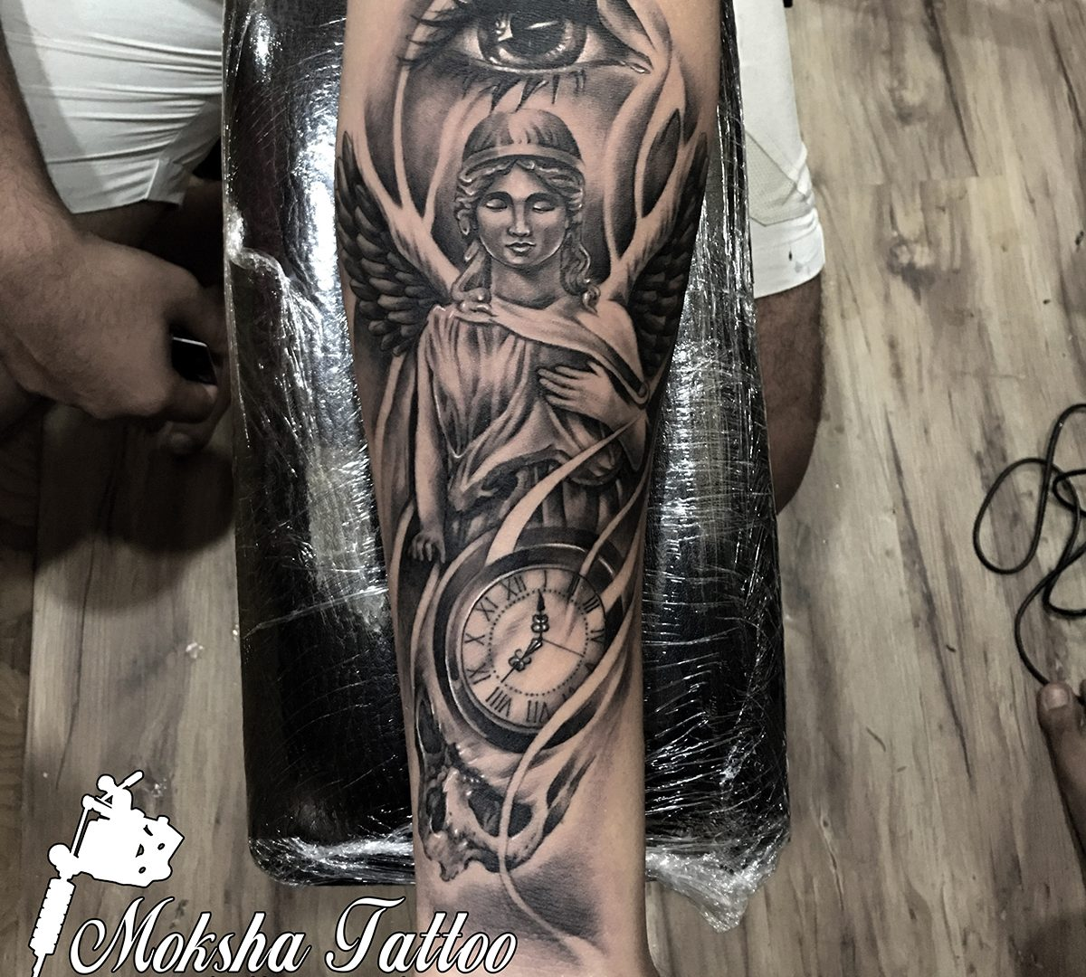 Best Tattoo Artists And Studio Of India With Safe Tattoo: Angel Eye Clock Skull Tattoo