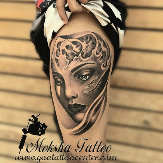 girl face Tattoo done by Mukesh Waghela at Moksha Tattoo Studio Goa India